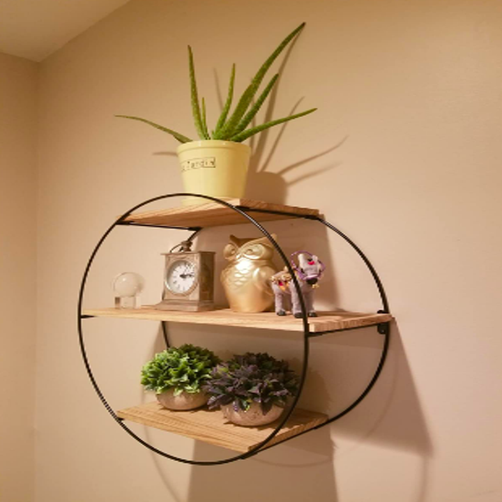 Round metal mount with three natural wooden shelves, reviewer image