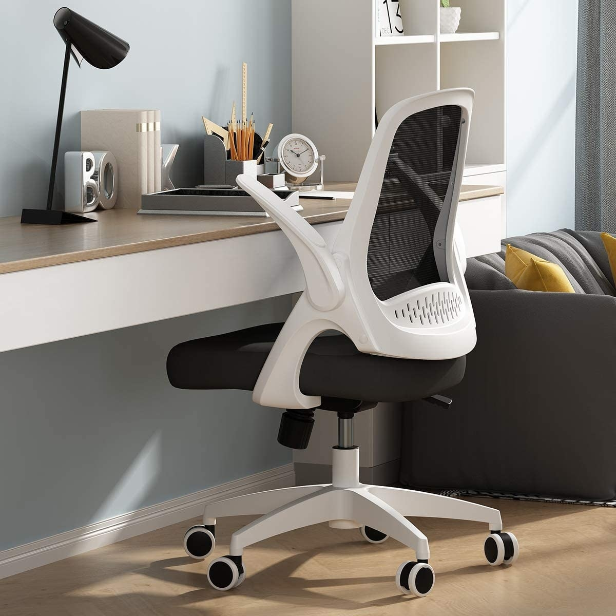 Swivel chair with padded seating and lumbar support