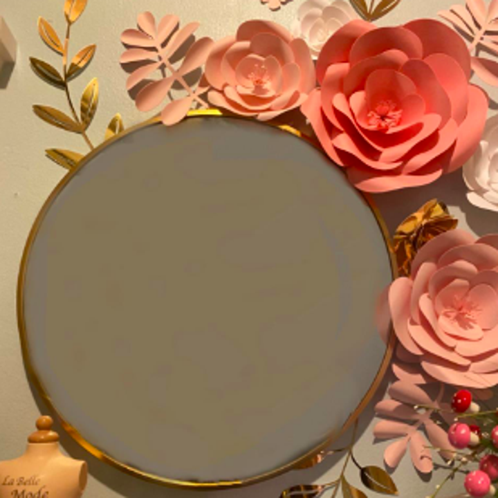 Reviewer's mirror in gold with paper flowers around edges