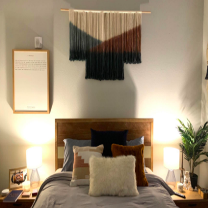 Reviewer with hanging above headboard in bedroom