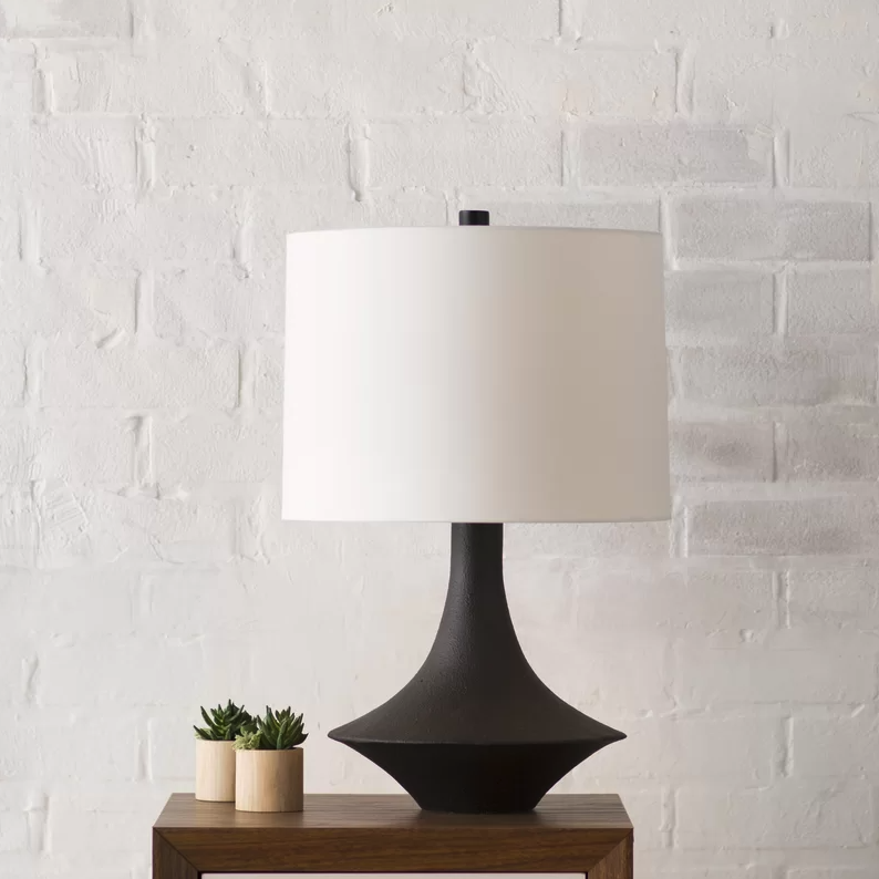 the lamp in black on a side table