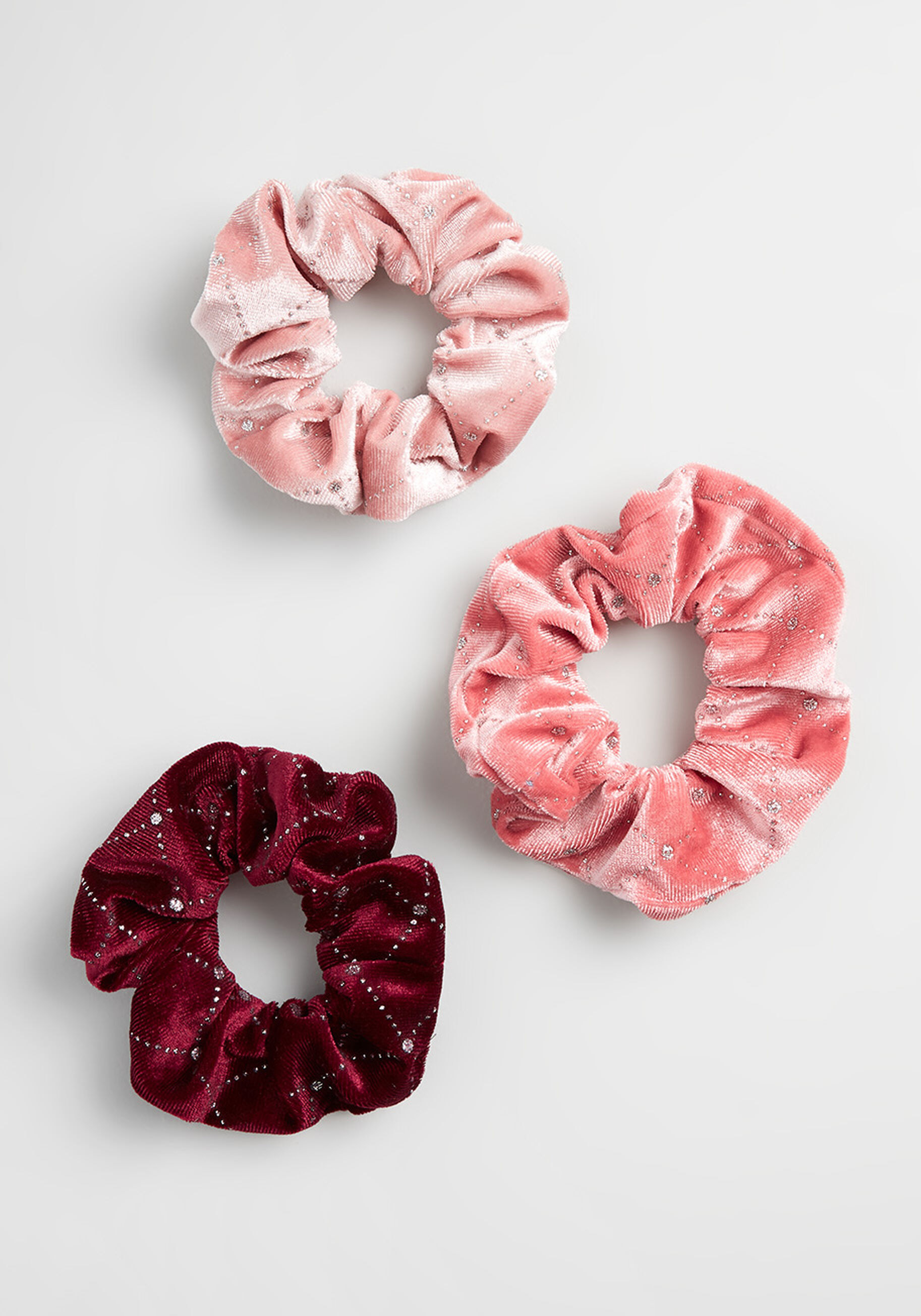 pink, rose, and burgundy velvet scrunchies