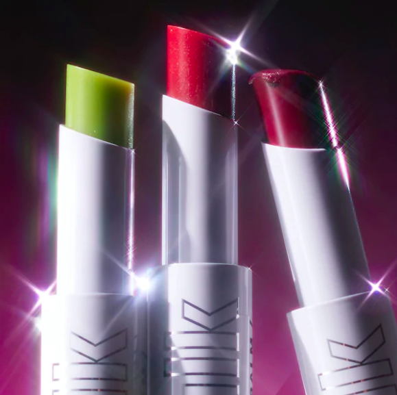 A trio of lip balms with lens flares decorating them