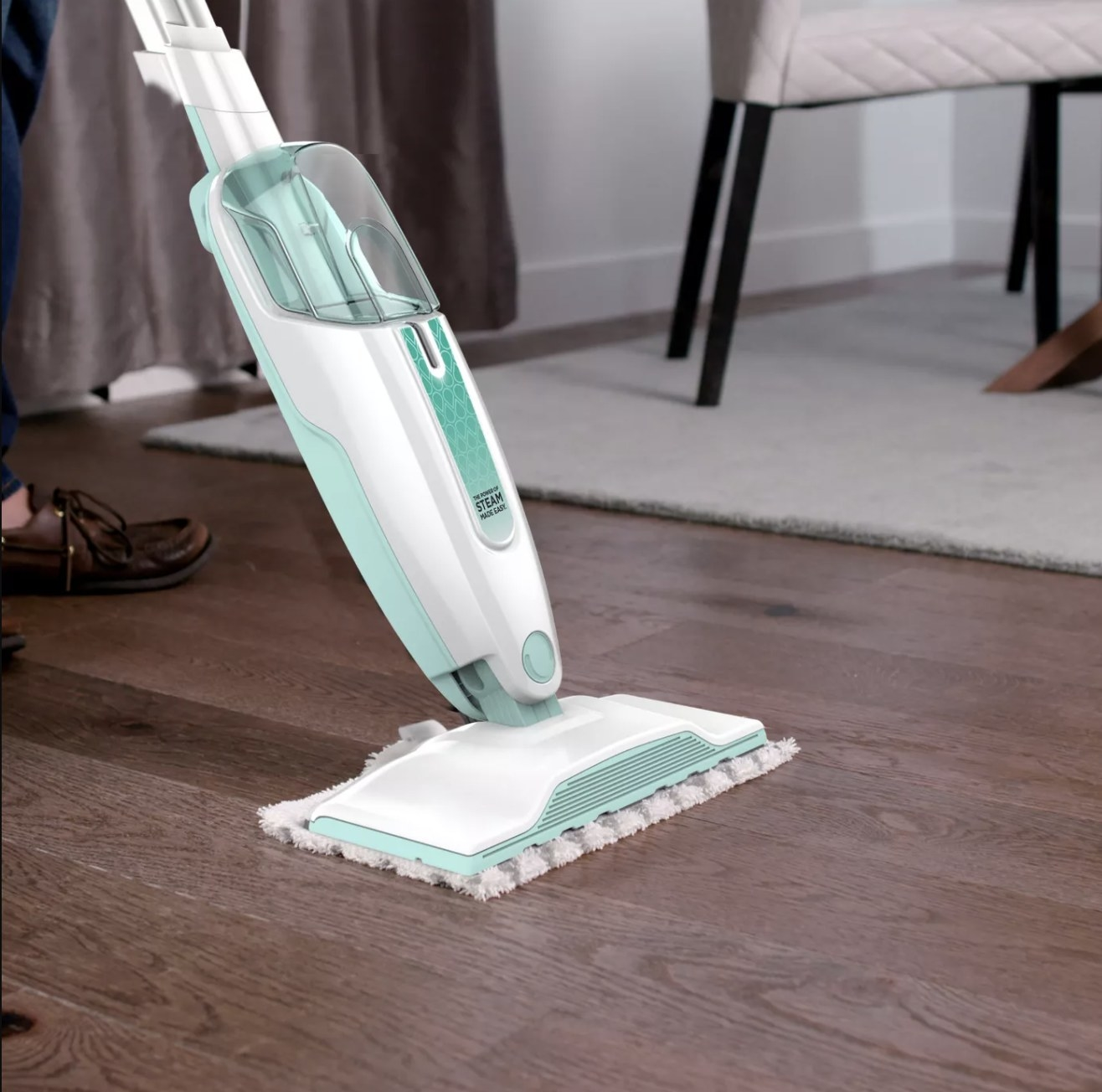 The steam mop cleaning a hardwood floor