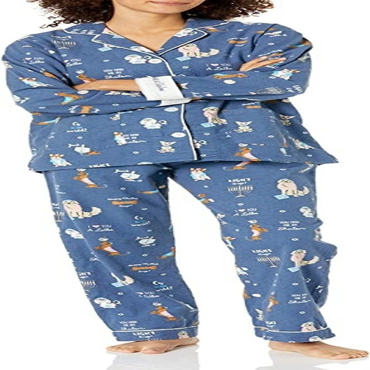 a model wearing blue flannel pjs with dogs on them