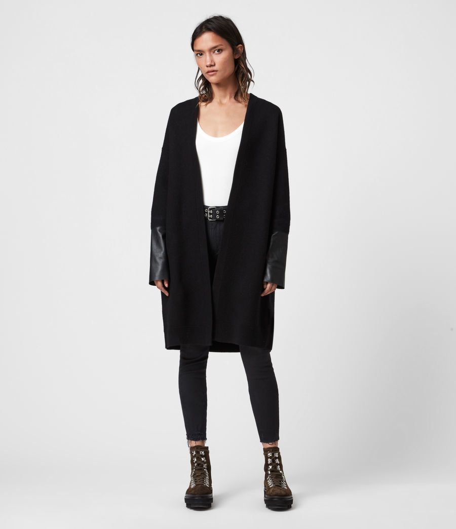 Model wearing the black knee-length open cardigan with leather cuffs