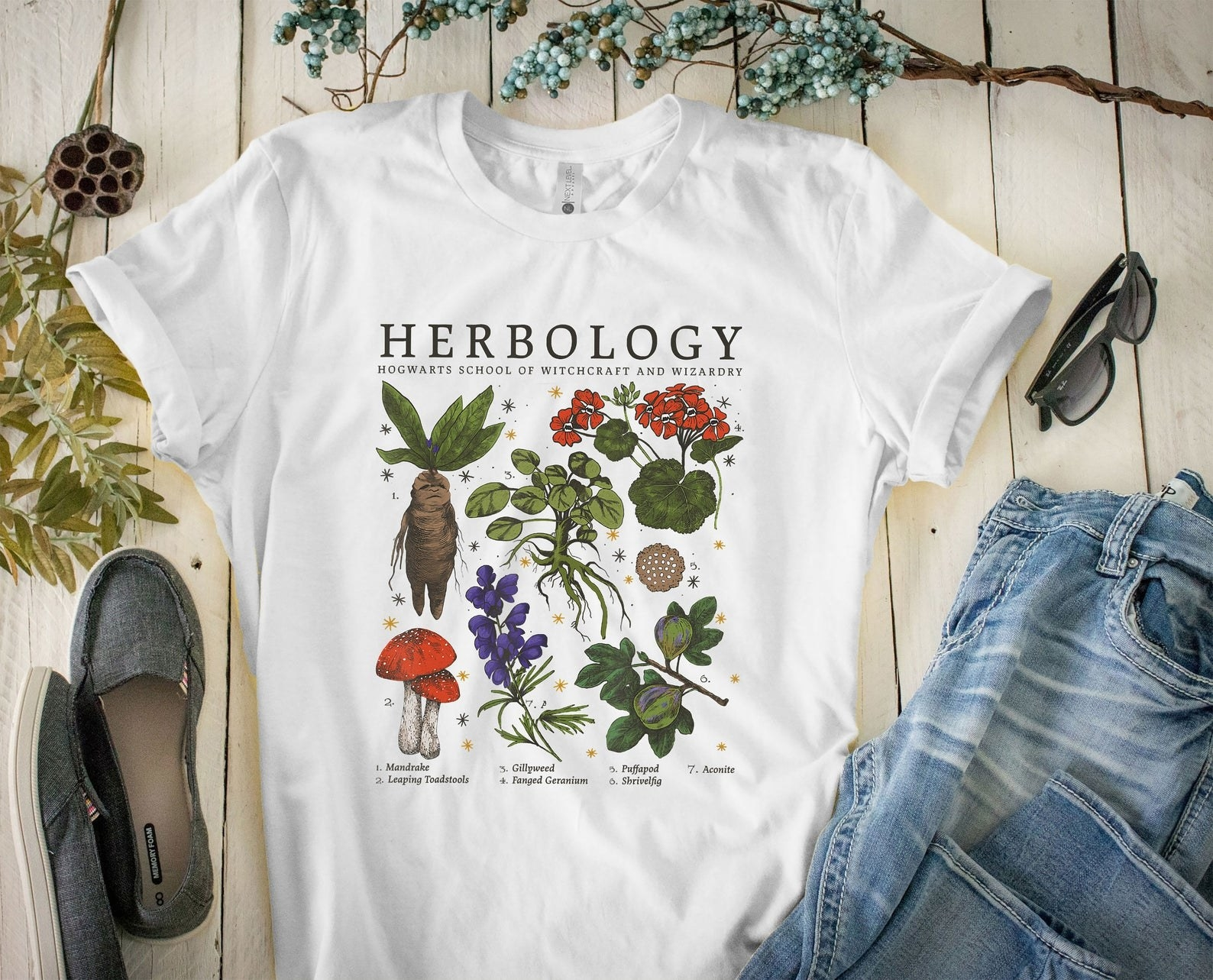 the white tee with Herbology printed on it