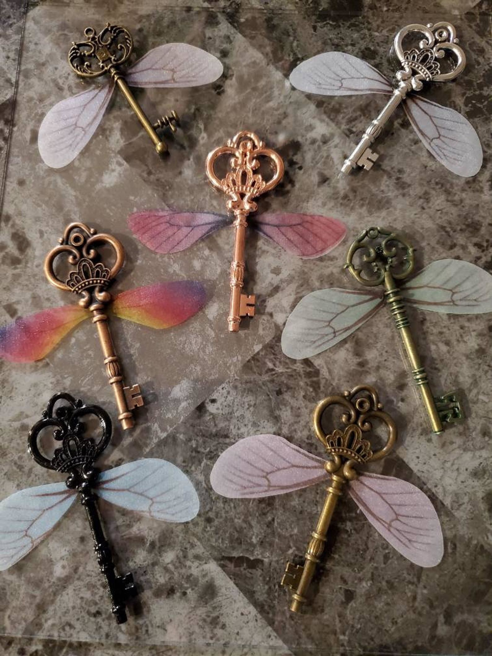the keys with colored wings attached to them