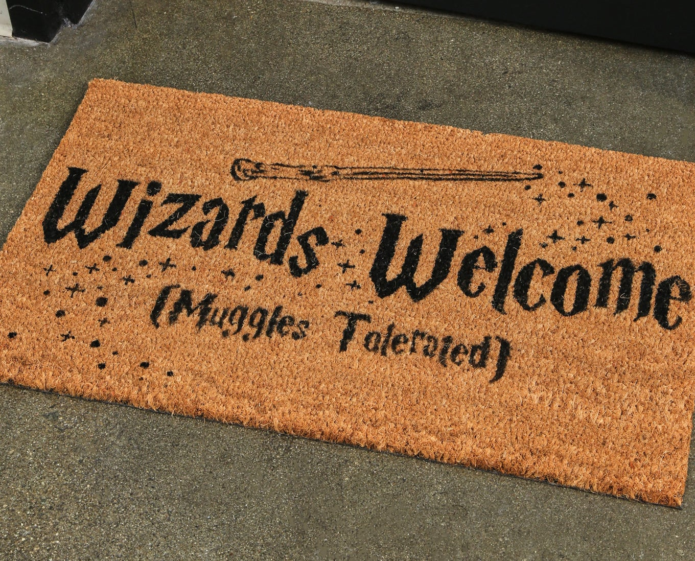 """the mat with text """"Wizards Welcome (Muggles Tolerated)"""""""