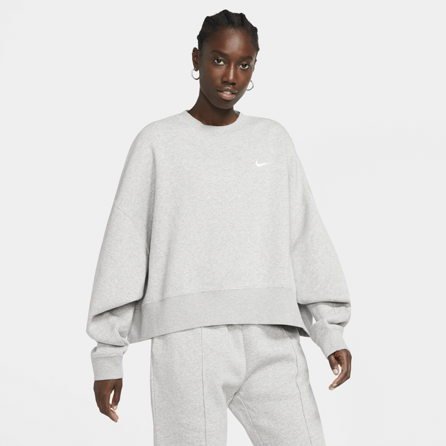 The light gray slightly cropped sweater with a small white Nike logo on the left chest