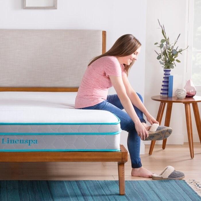 Woman sitting on the soft mattress