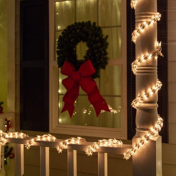 The lights wrapped around a porch