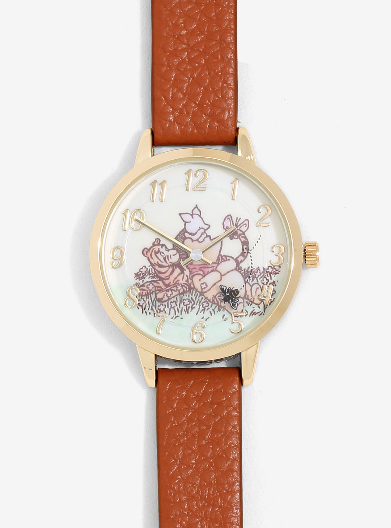the watch with the book version of pooh, piglet, and tigger inside the watch face