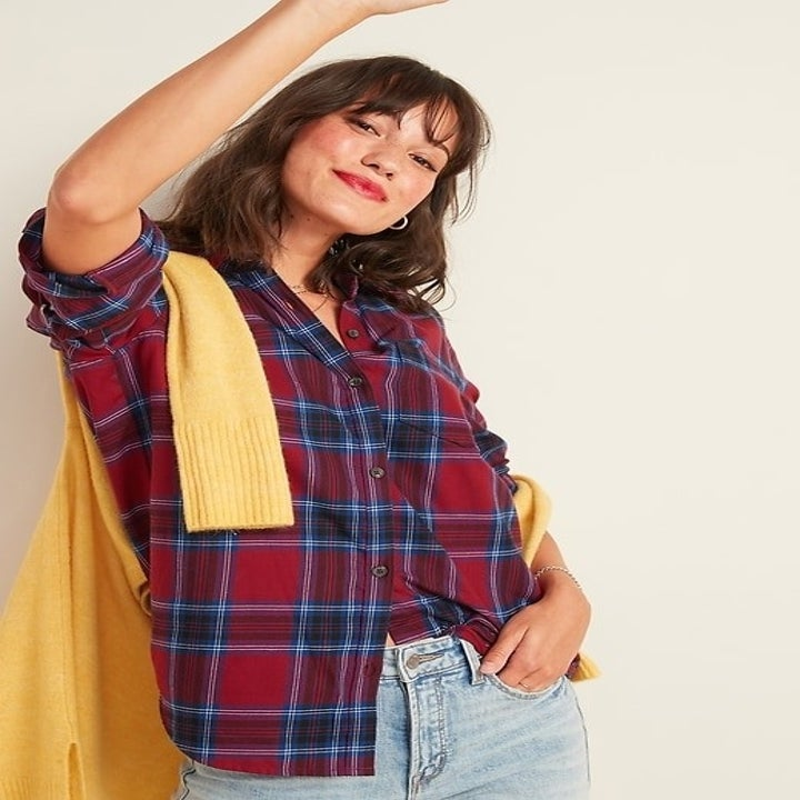 Model wearing red and blue plaid button-up