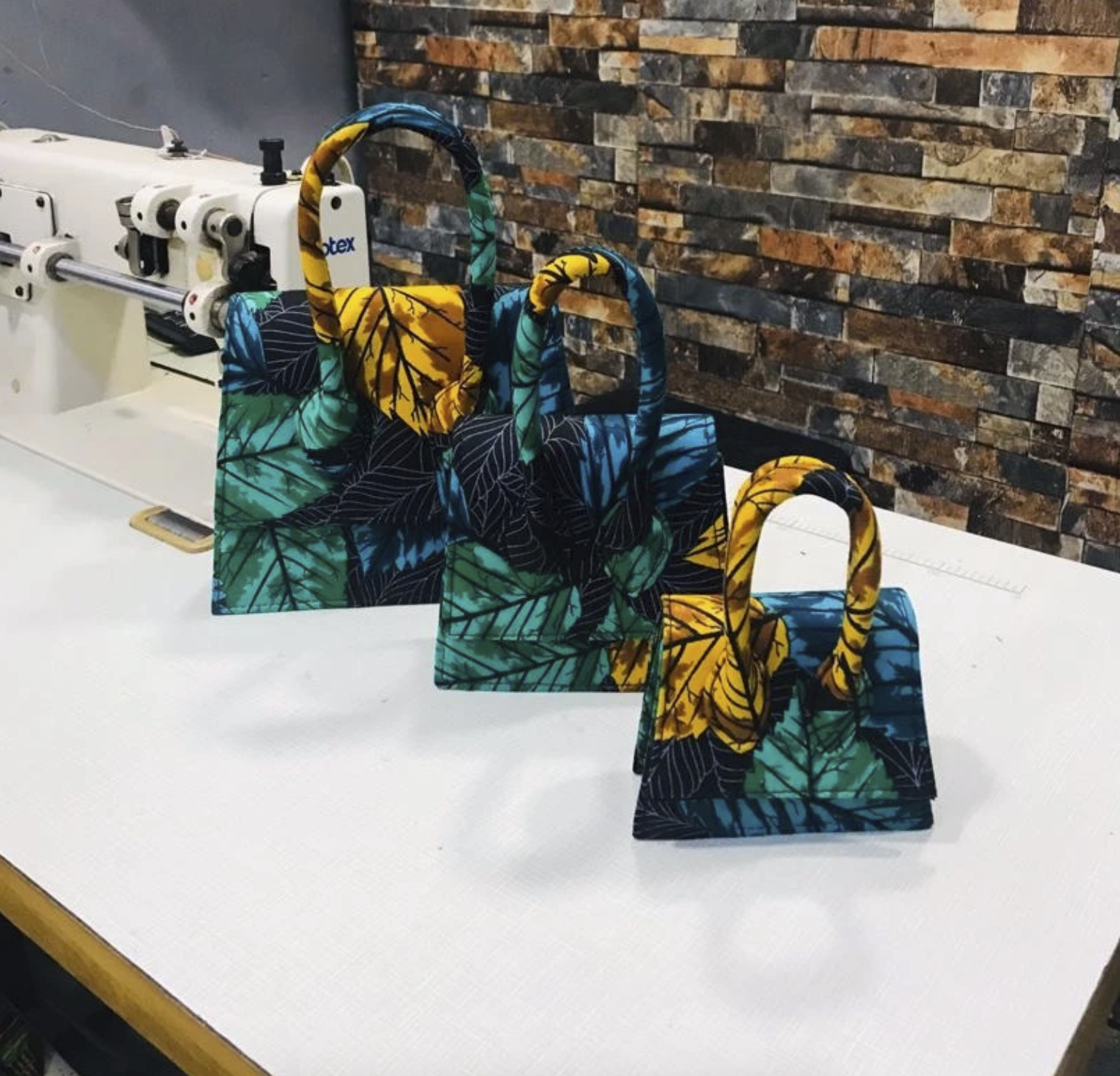 three bags in sizes graduating from small to largest with the sample floral print that's a green, blue, and yellow
