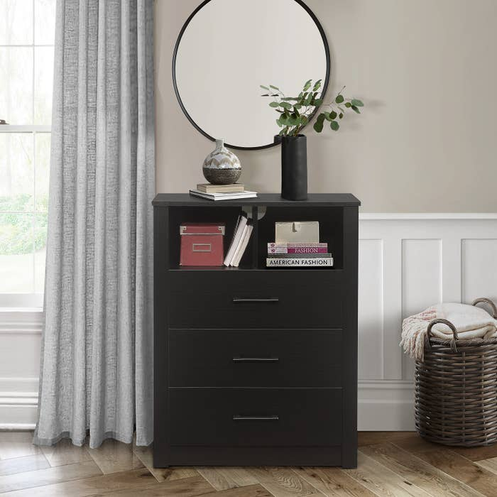 A black dresser with 3 drawers