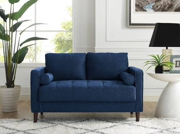 A blue loveseat for small spaces