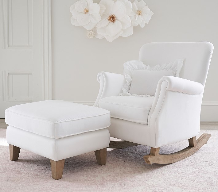 a white rocker and ottoman set