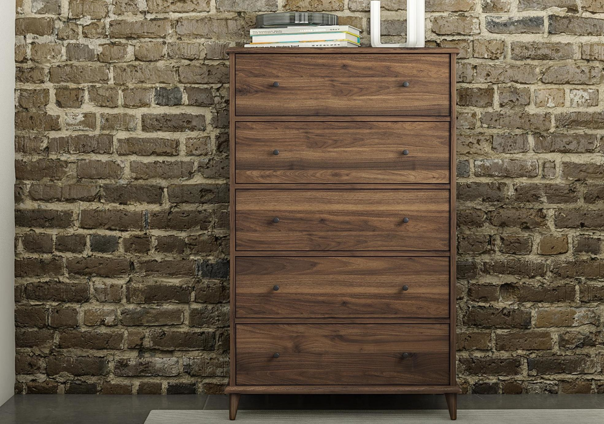 A brown 5- drawer in a home