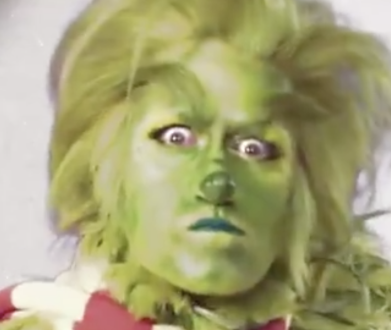 A closeup of Matthew Morrison as the Grinch