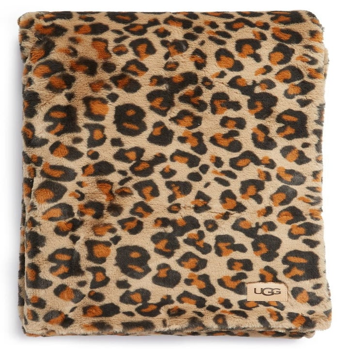a leopard print throw blanket