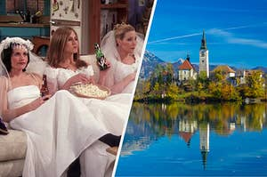 "The women from ""Friends"" are sitting on a sofa wearing wedding dresses with a view of a lake and mountain on the right"