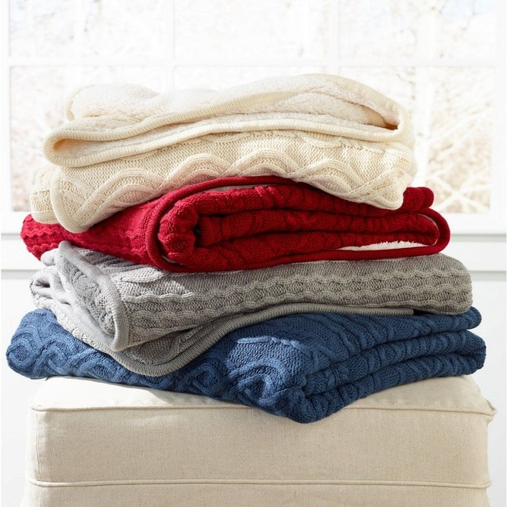 A stack of knit blankets