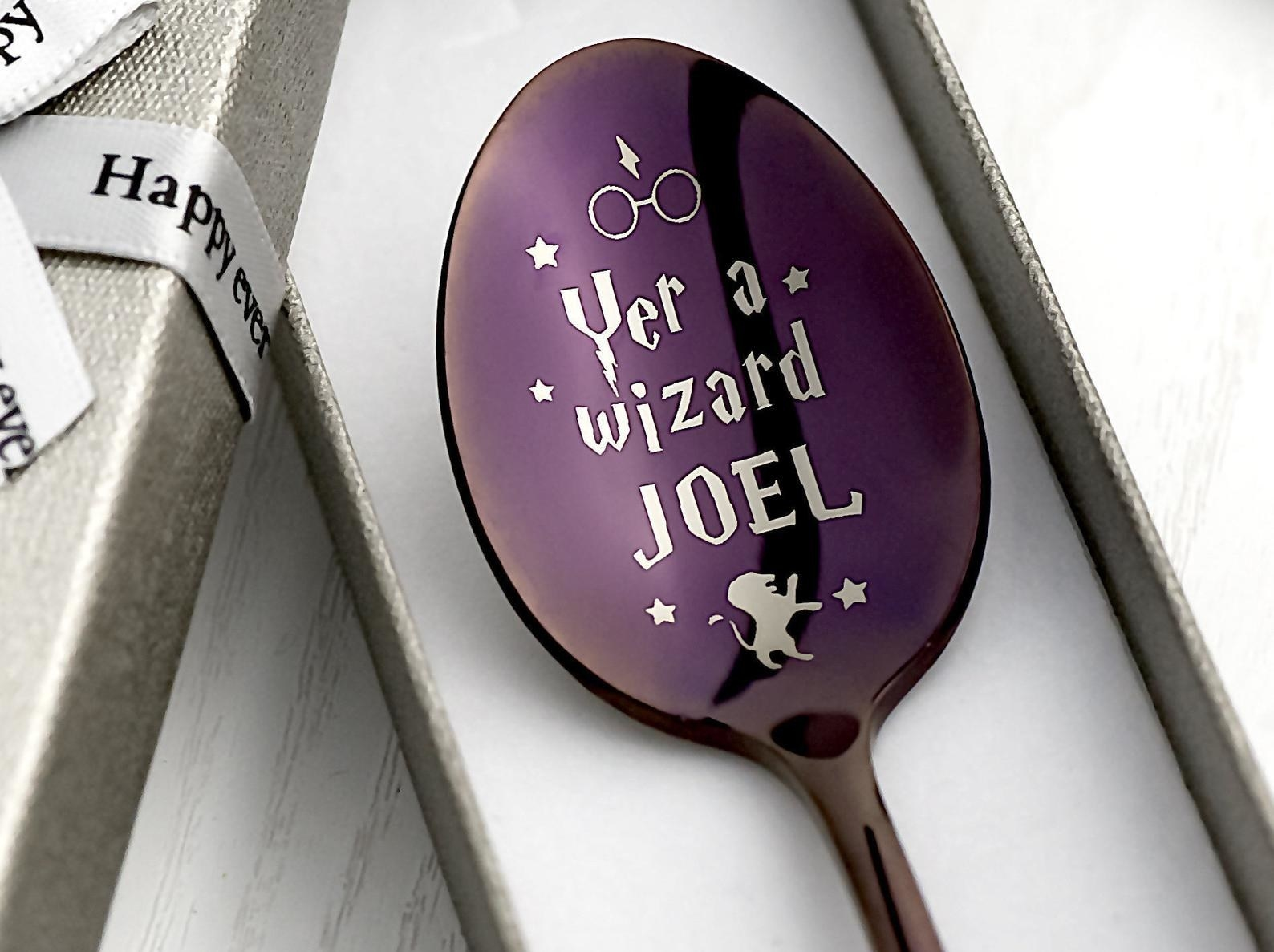 """the purple spoon with engraved text that says """"yer a wizard Joel"""""""