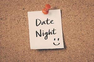 note tacked to a cork board that says date night