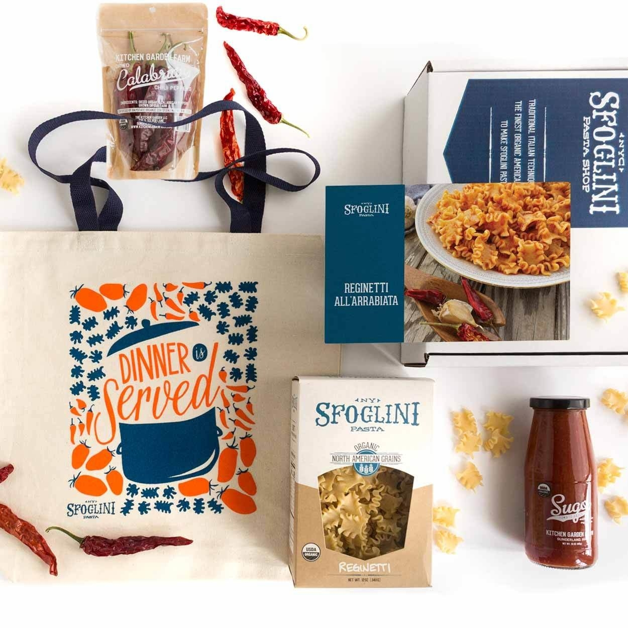 the gift set (including a box of pasta, calabrian chilis, arrabbiata sauce, a canvas tote bag, and a recipe card)