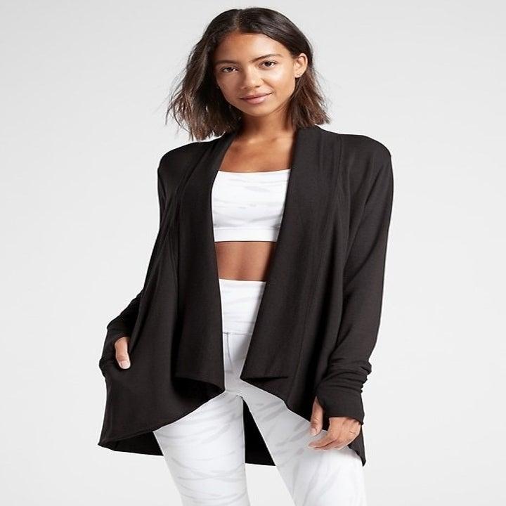 model wearing black open cardigan