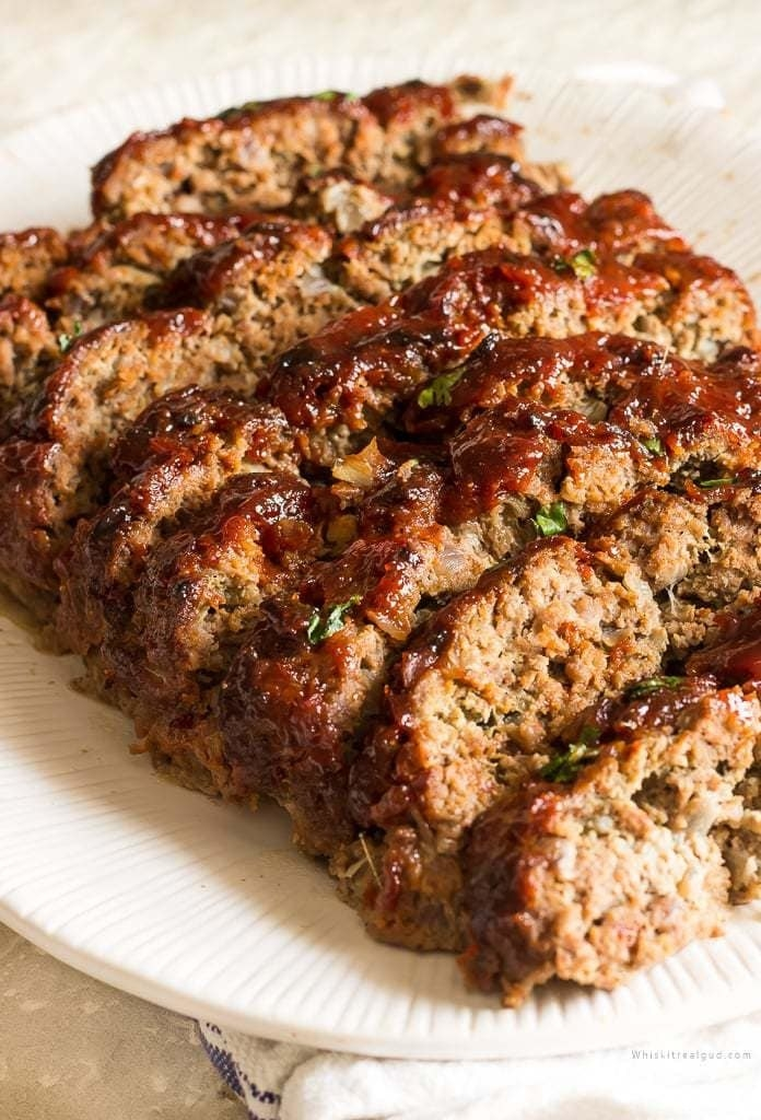 A meatloaf cut into slices on a plate.