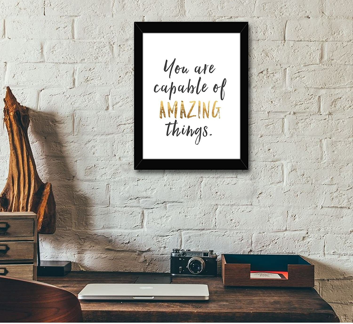 """The frame reads, """"You are capable of amazing things"""" in gold and black text."""