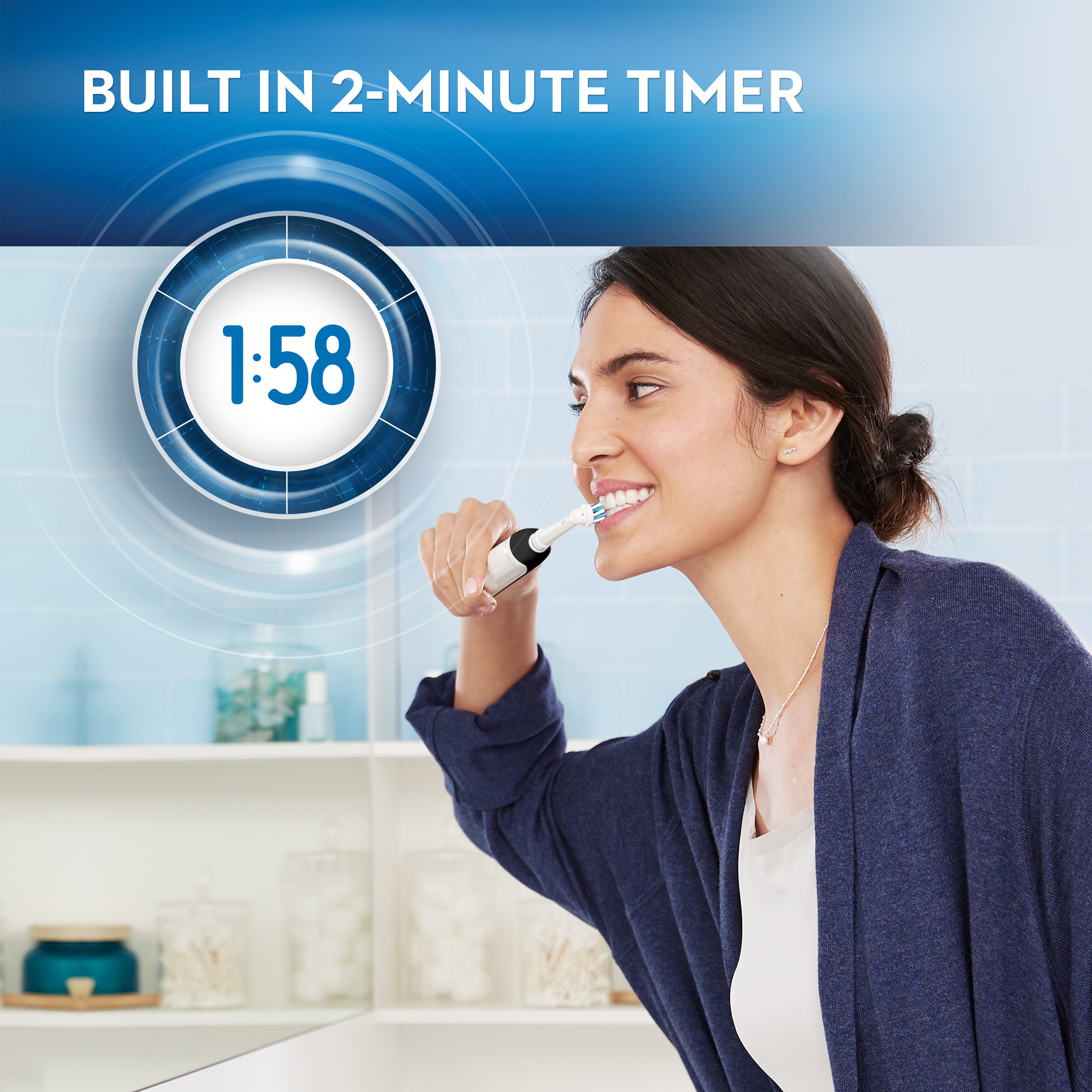 Model is brushing her teeth with an electric toothbrush