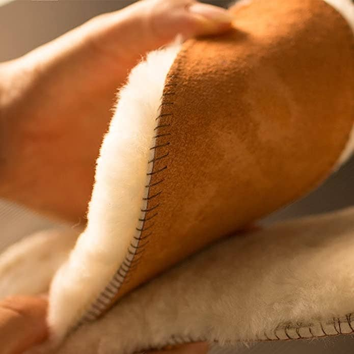 A person holding a pair of fluffy sheepskin insoles