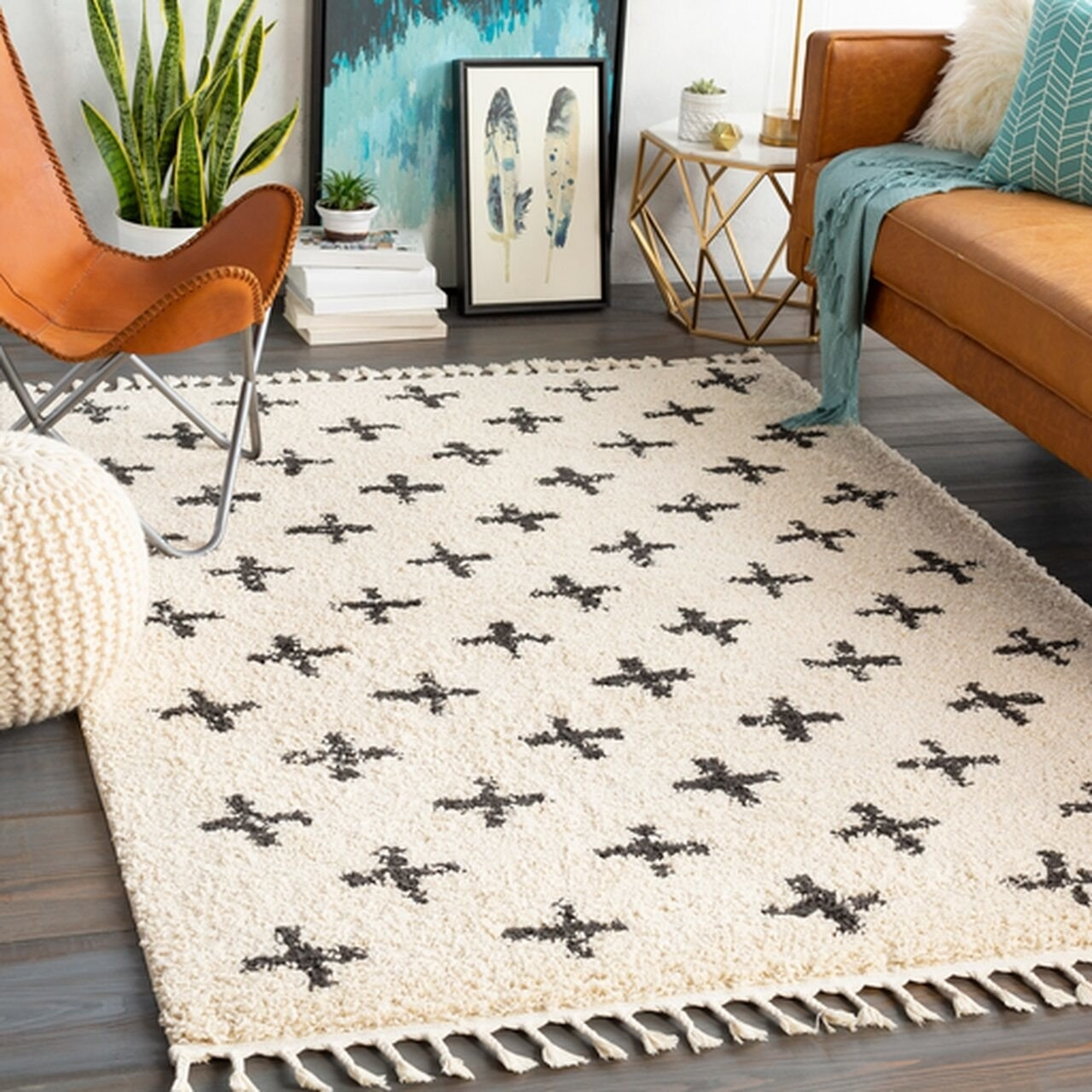 White textured rug with tassels on edges and black plus sign pattern throughout