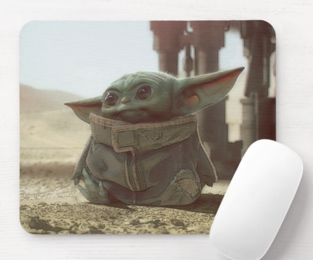 mousepad featuring a still of baby yoda sitting on the ground