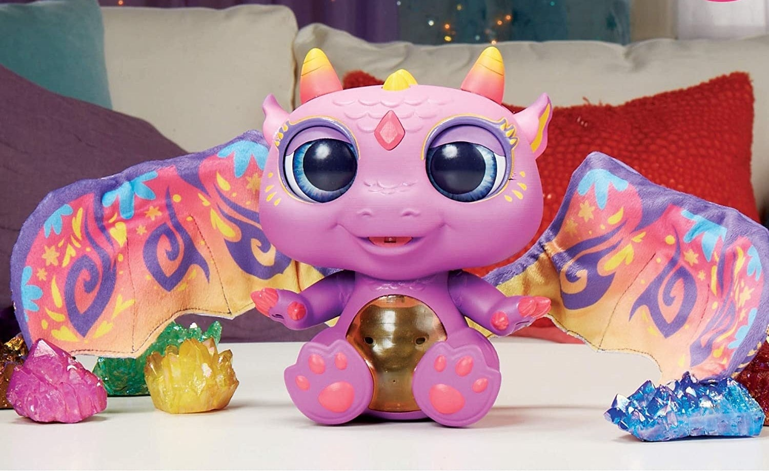Purple toy dragon with wings extended and fire crystals