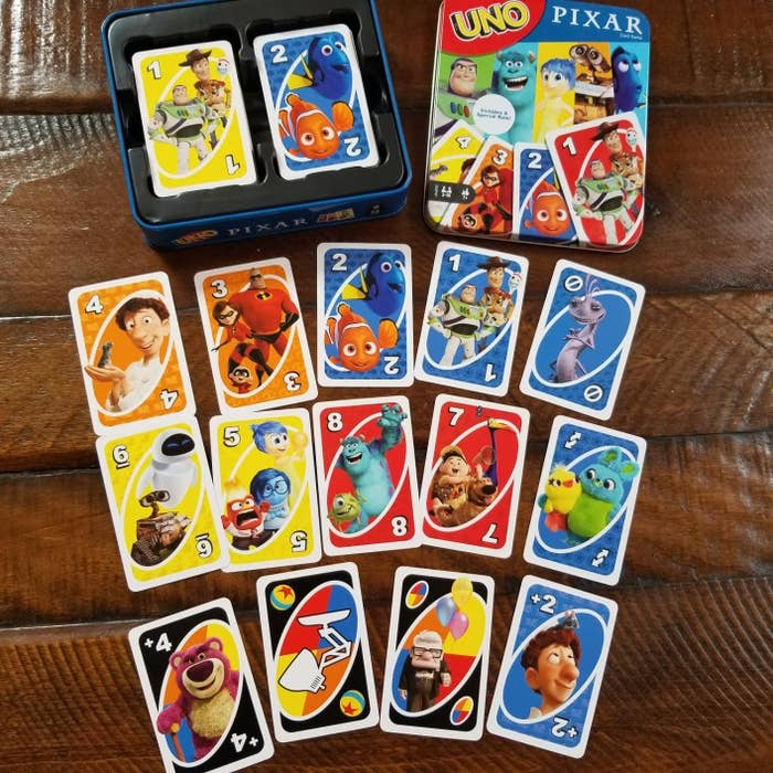 deck of uno cards with characters from ratatouille, finding nemo, the incredibles, up, toy story, and more