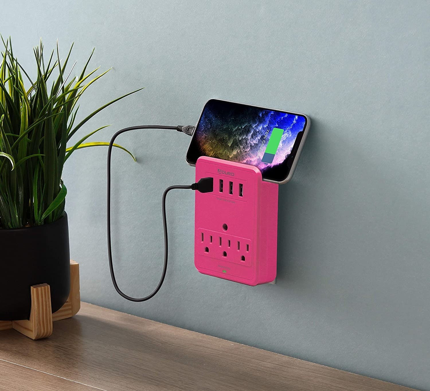 The surge-protecting outlet with a phone plugged into it