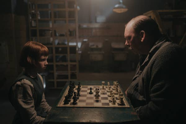 ISLA JOHNSTON as BETH (ORPHANAGE) and BILL CAMP as MR. SHAIBEL in episode 101 of THE QUEEN'S GAMBIT