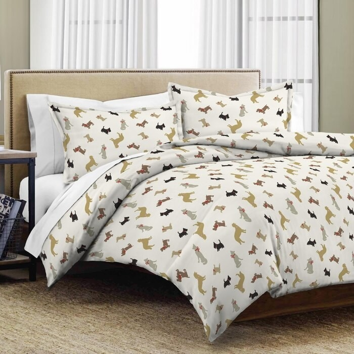 The alcott hill dogs duvet cover set on a bed