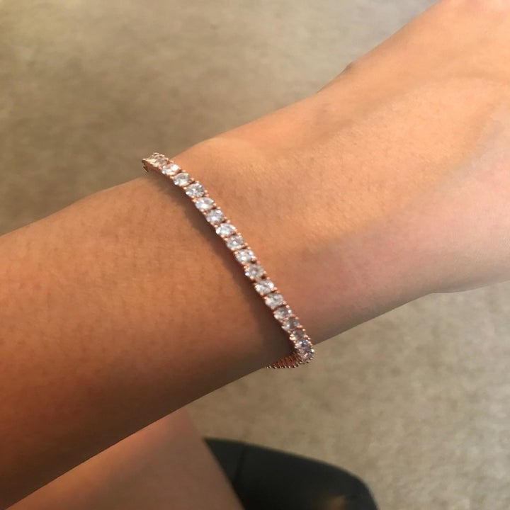 Reviewer photo showing close up of tennis bracelet in rose gold