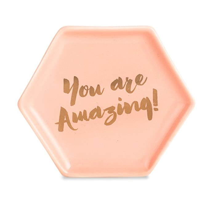 Pink porcelain dish with the words Your Are Amazing' printed on it.