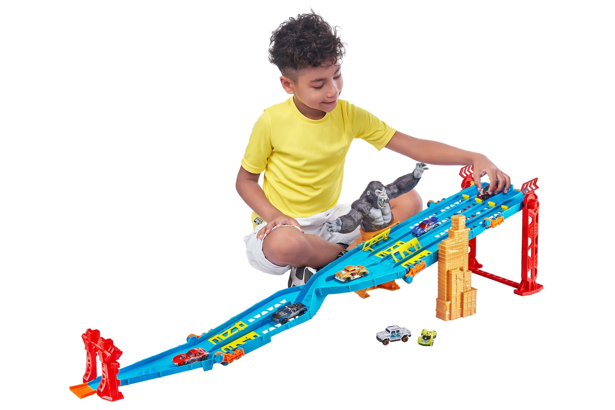 kid playing with a car racing track