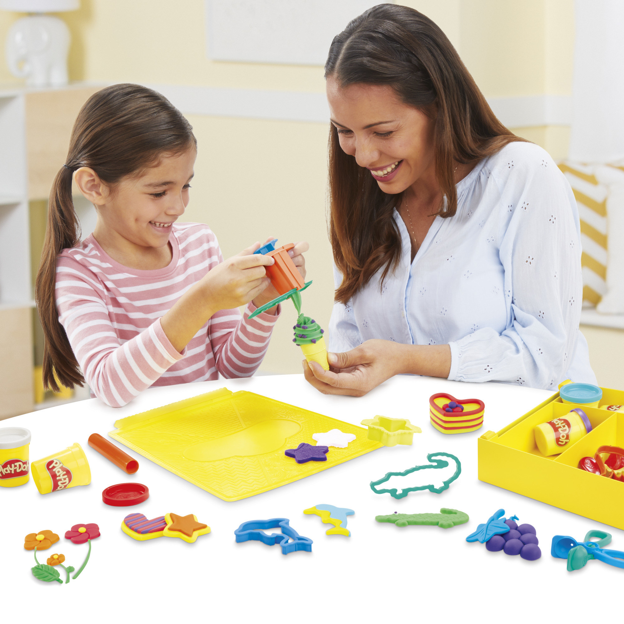 a parent and a child playing with play doh