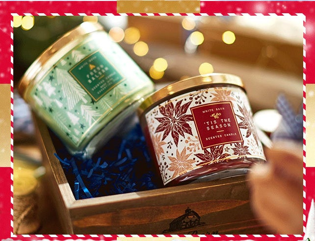 two three-wick winter candles