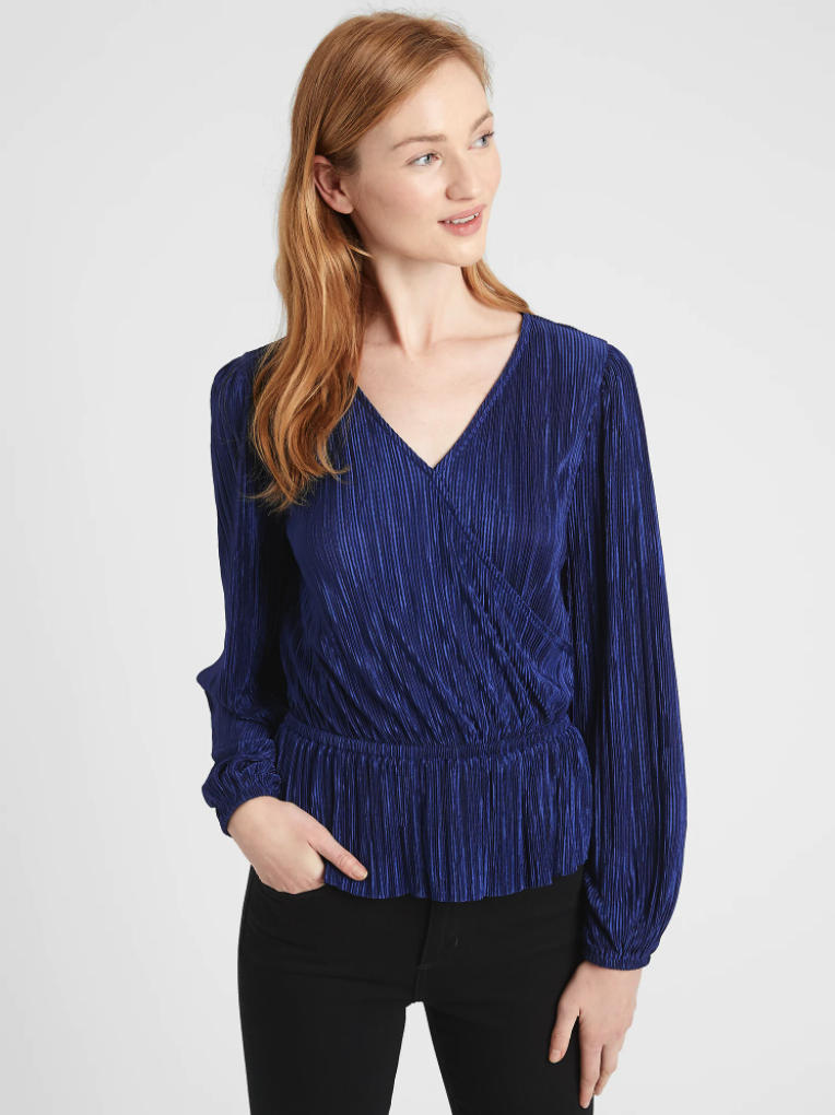 person wearing a blue wrap top