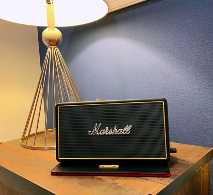reviewer photo showing Marshall speaker on a table with a lamp
