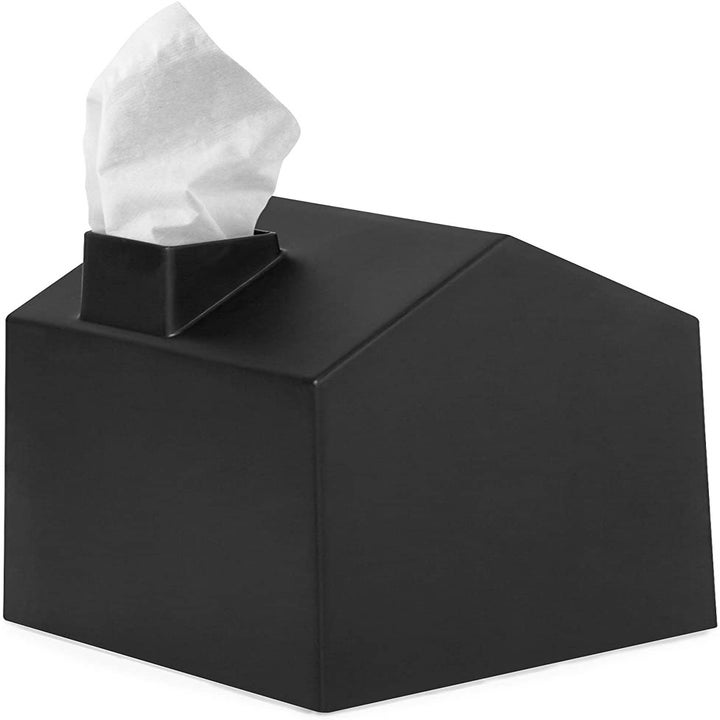A three-dimensional plain black tissue box cover with a facial tissue coming out of the chimney